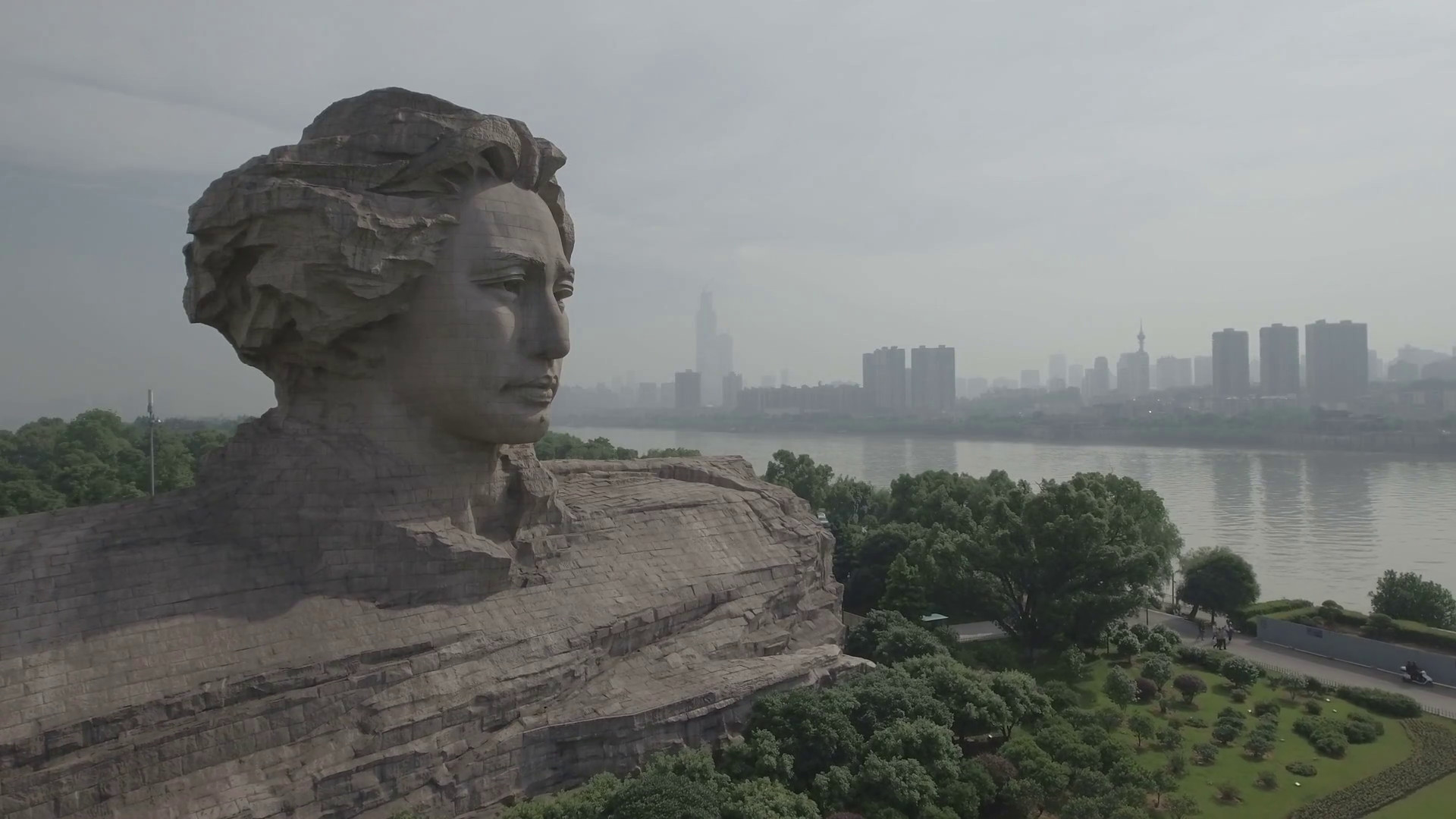 Res: 1920x1080, Aerial drone view of a massive statue of the head of Mao Zedong, founder of  the People's Republic of China, in Changsha Stock Video Footage -  Videoblocks