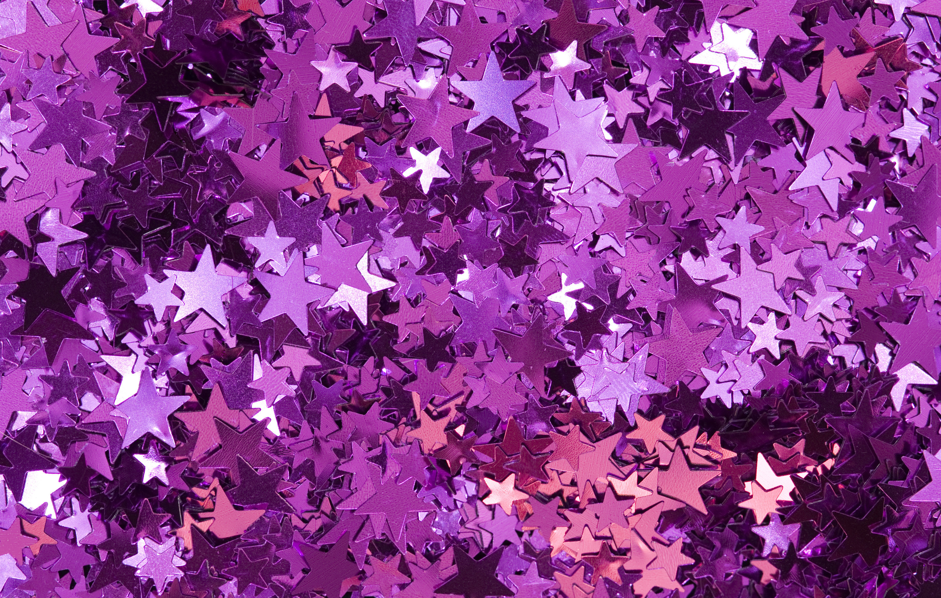 Res: 3000x1909, a colorful pink backdrop of metallic confetti star shapes