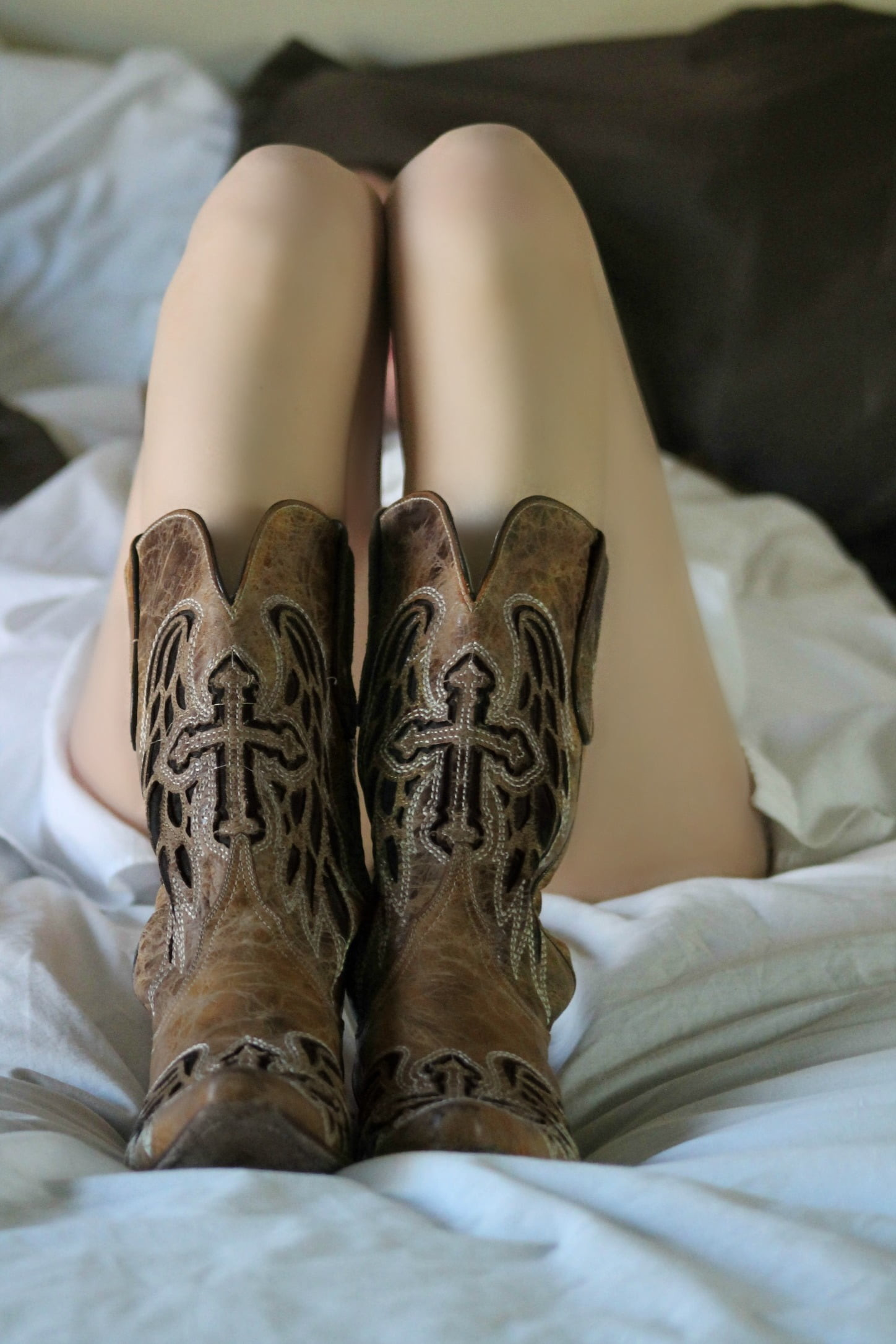 Res: 1448x2172, woman lying in bed with brown leather cowboy boots HD wallpaper