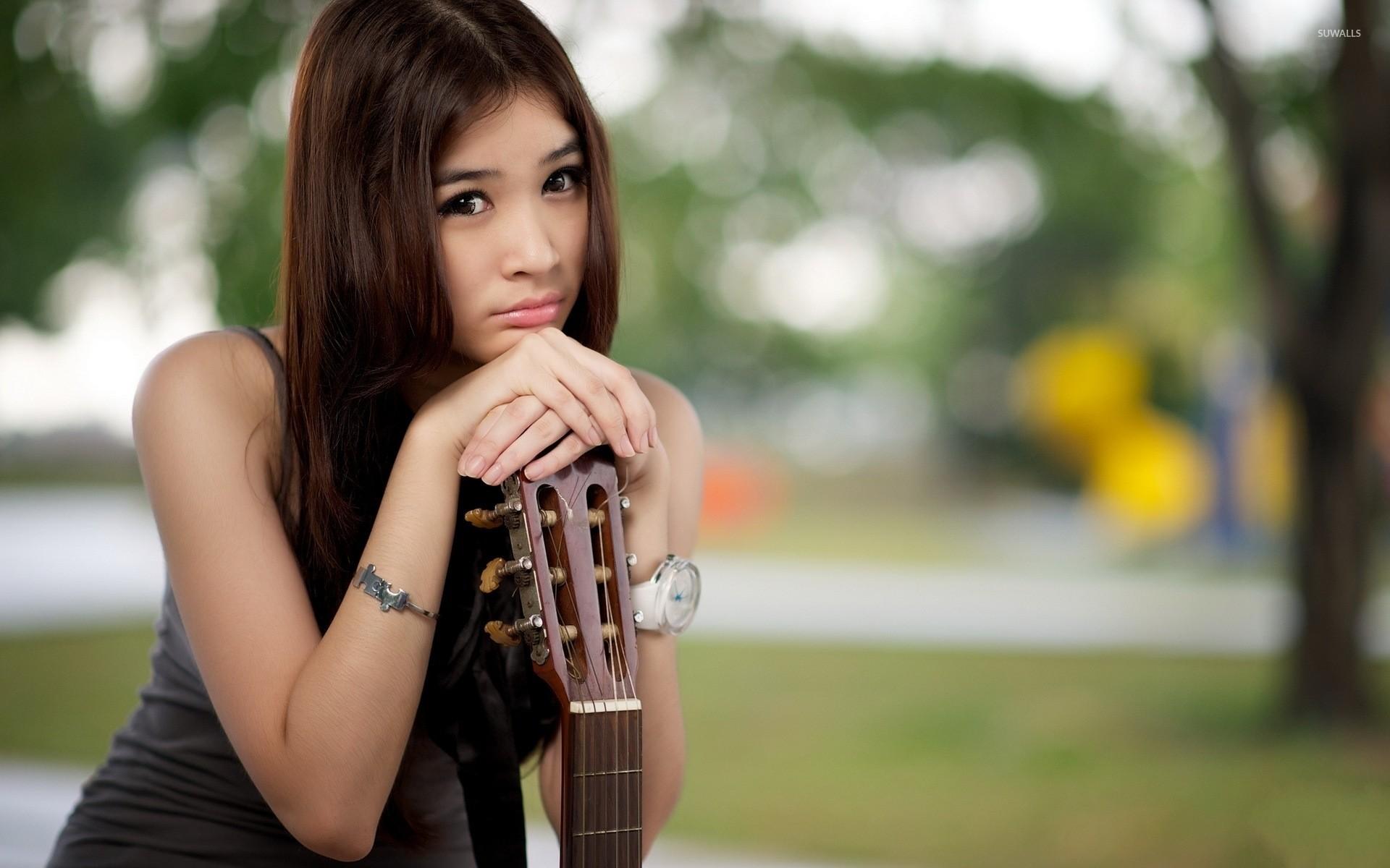 Res: 1920x1200, Sad asian girl with a guitar wallpaper