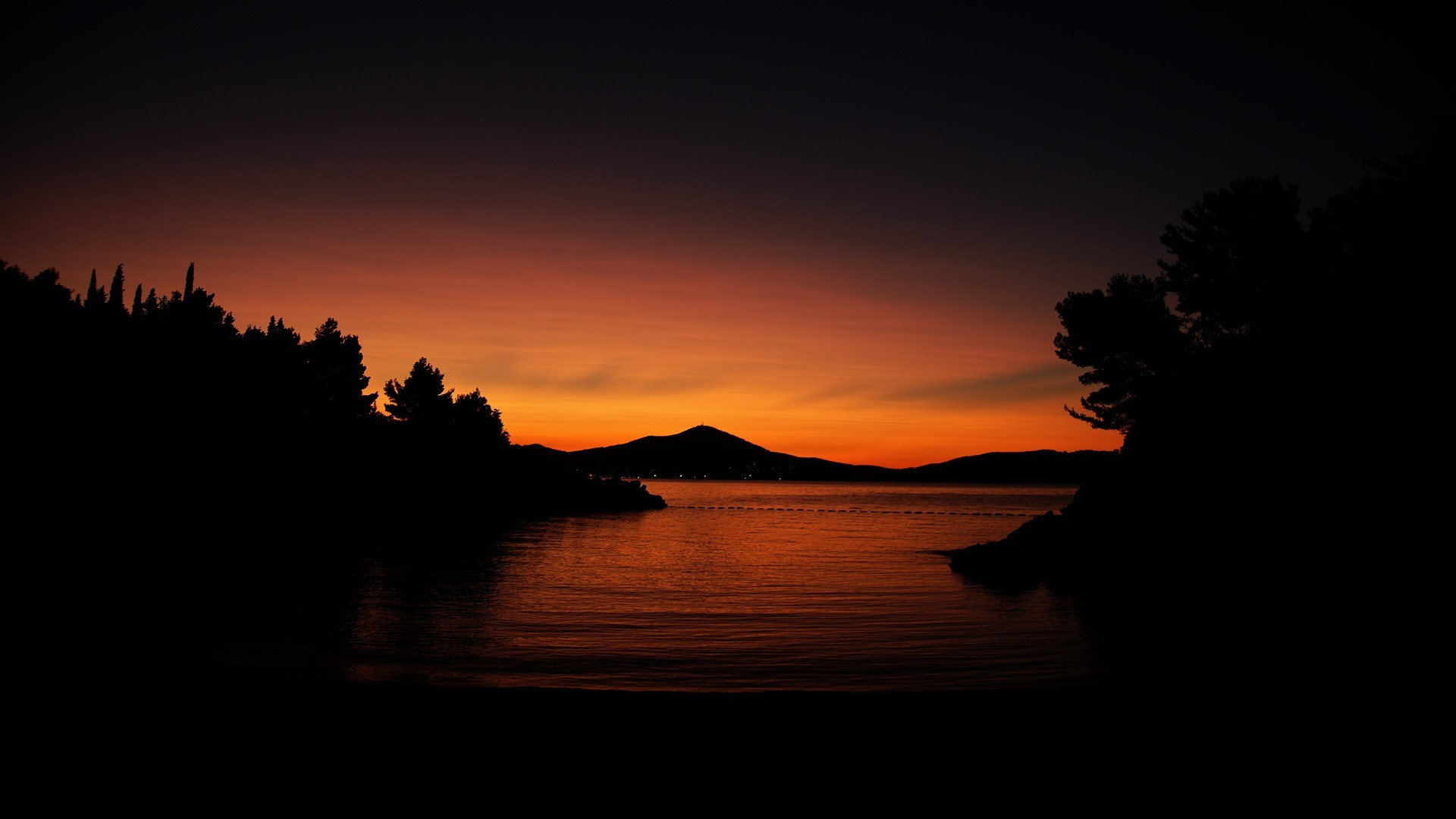 Res: 1920x1080, sunset, Nature, Silhouette, Trees, Water, Calm, Dark, Orange, Hill  Wallpapers HD / Desktop and Mobile Backgrounds