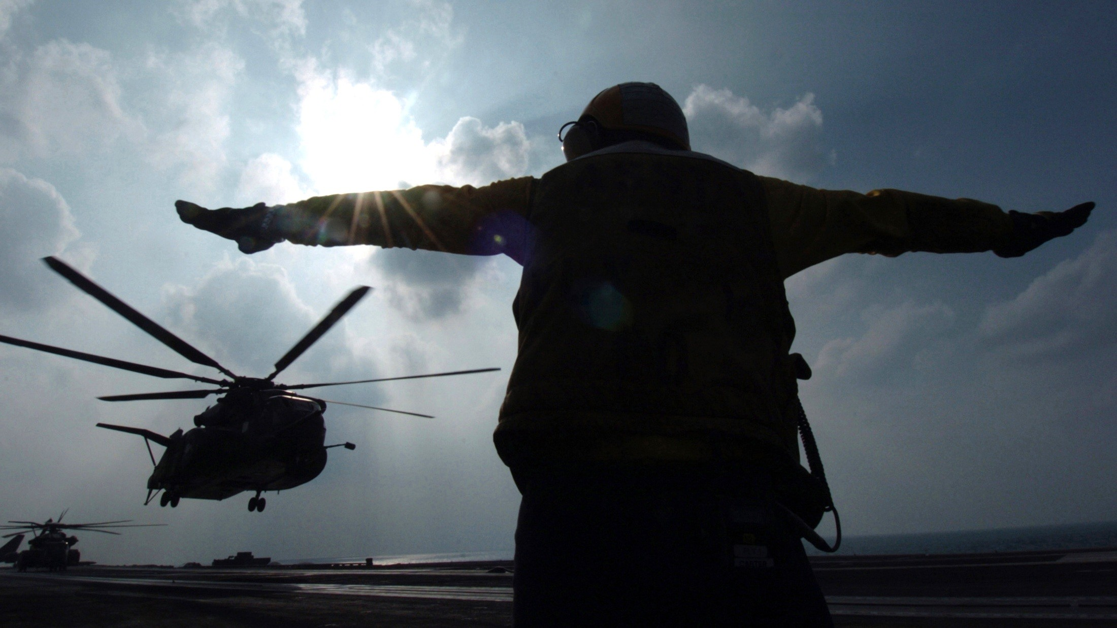 Res: 2200x1237, ... navy wallpaper 4 US serviceman signals helicopter at the Gulf south of  Iraq ...