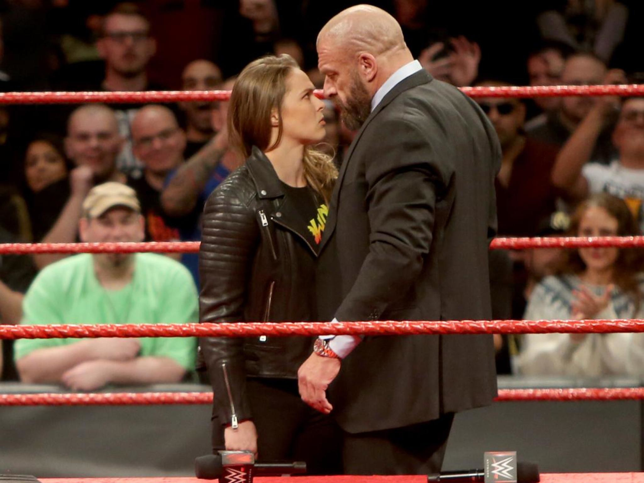 Res: 2048x1536, WWE Elimination Chamber results: Ronda Rousey throws Triple H through a  table after signing full-time contract | The Independent